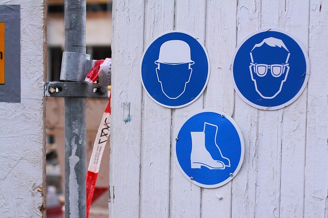 three signs with a helmet, glasses and boots